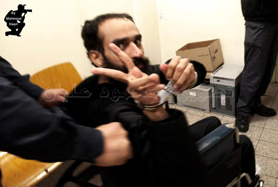 Samer Issawi making a V-sign