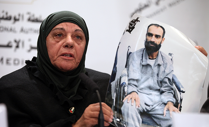 Mother of Samer Issawi holding his picture