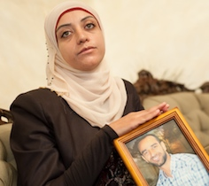 Shireen Issawi holding Samer's picture