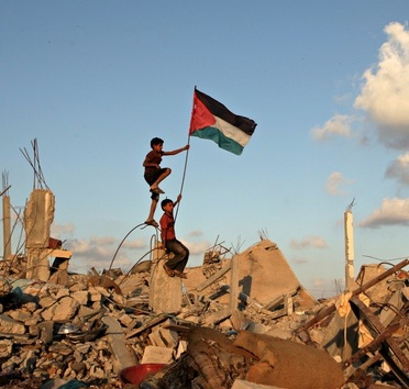 Child with Palestinian flag